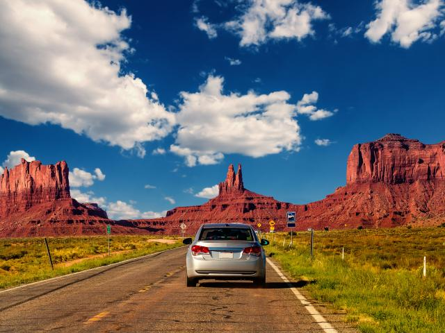Car driving along a highway in Monument Valley, Arizona