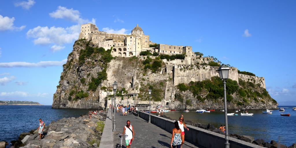Aragonese Castle is connected to Ischia Porto via a stone pedestrian bridge