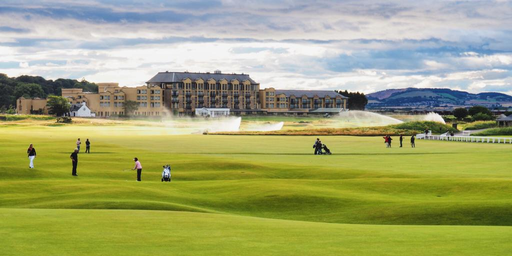 People play golf on the pristine Old Course in St Andrews, Scotland, on a cloudy day