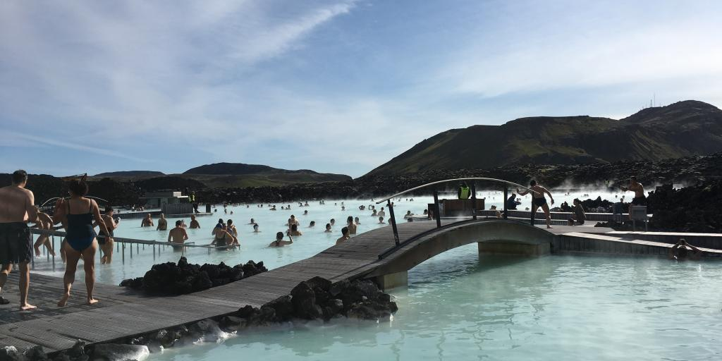 Bathers relax in the warm, milky blue waters of the Blue Lagoon