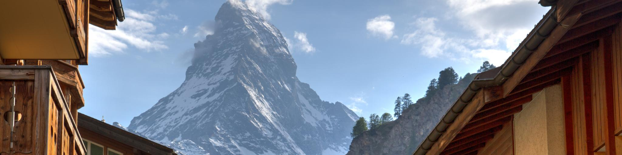 The Matterhorn mountain looms behind the buildings of Zermatt