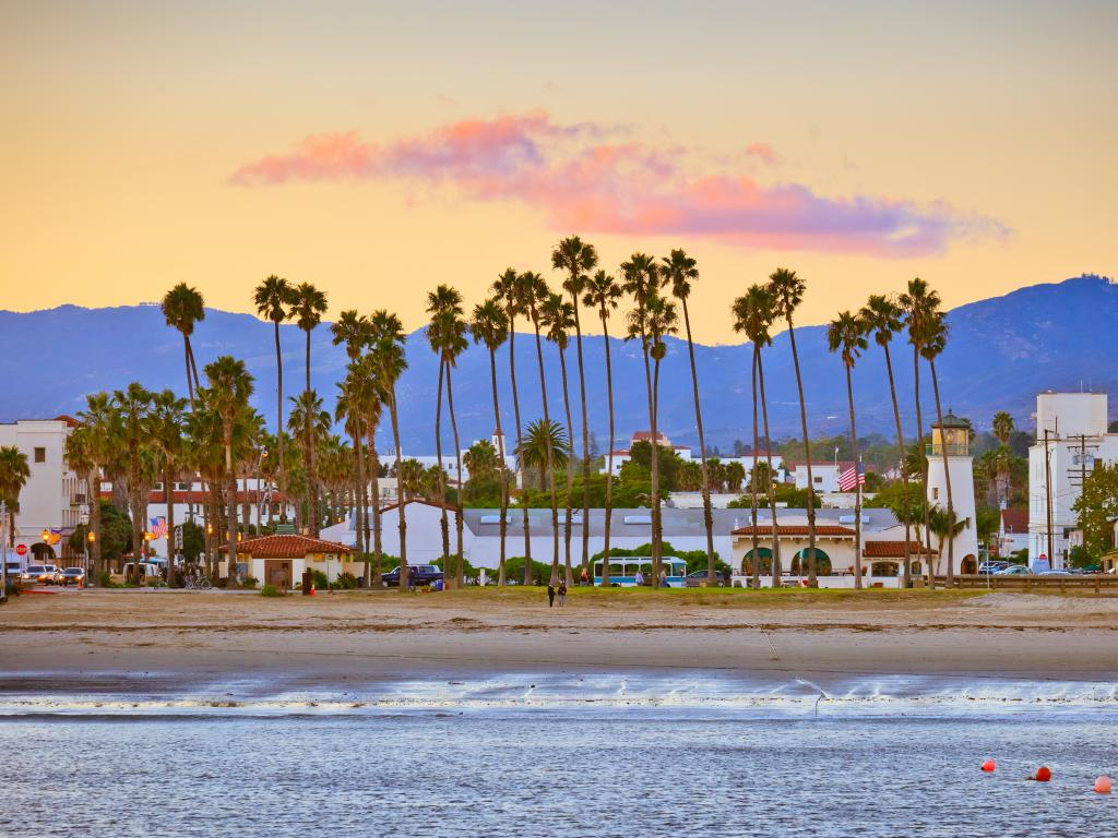 Santa Barbara beach and city with mountains in the background as seen from the pier at dusk.