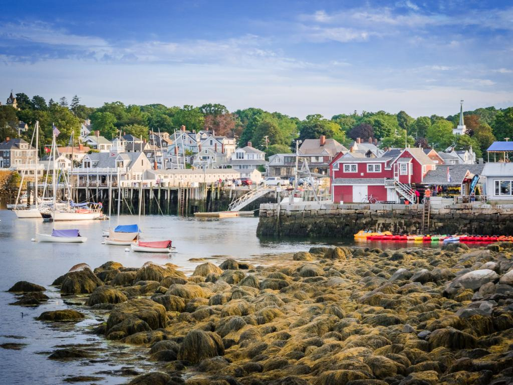 Small boats and colorful buildings in the pretty harbor of Rockport, Massachusetts.