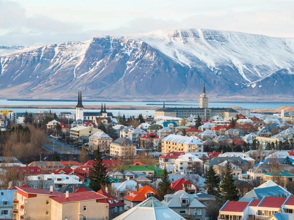 Scenic view of Reykjavik with mountains in the background during winter