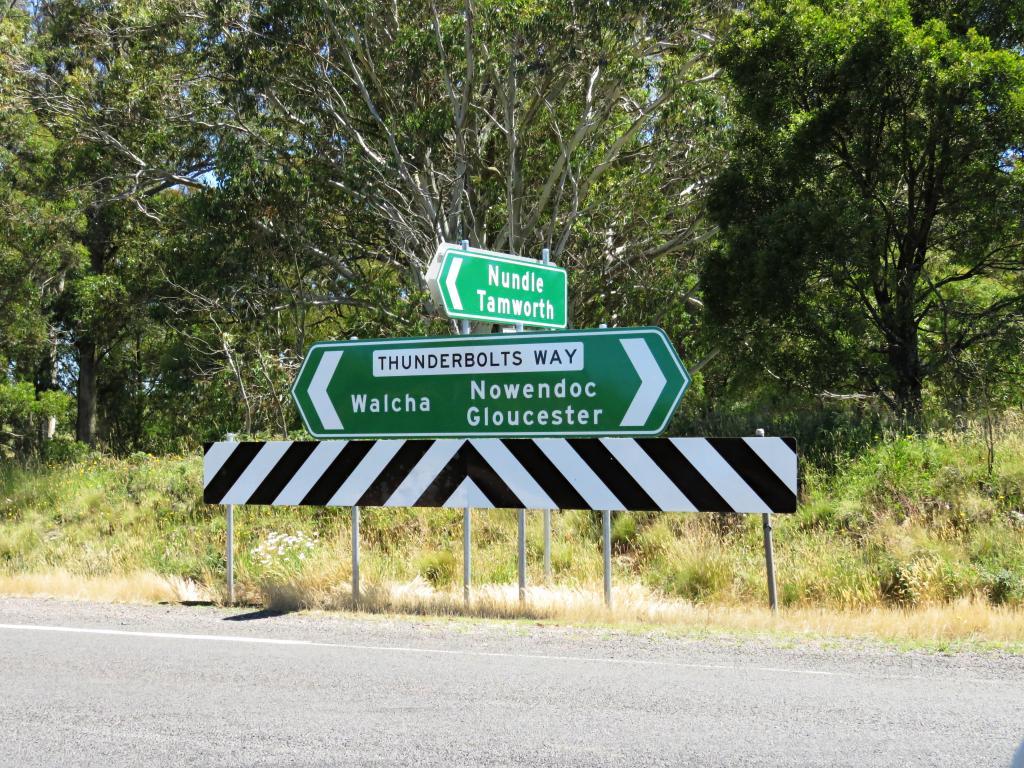 Road sign pointing to Thunderbolts Way in the Northern Tablelands, Australia.