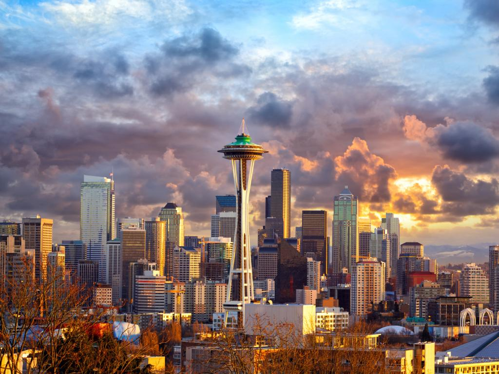 The futuristic Space Needle dominates the Seattle skyline on a cloudy day