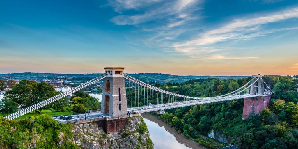 The Clifton Suspension Bridge, Bristol, at sunset with the muddy river below