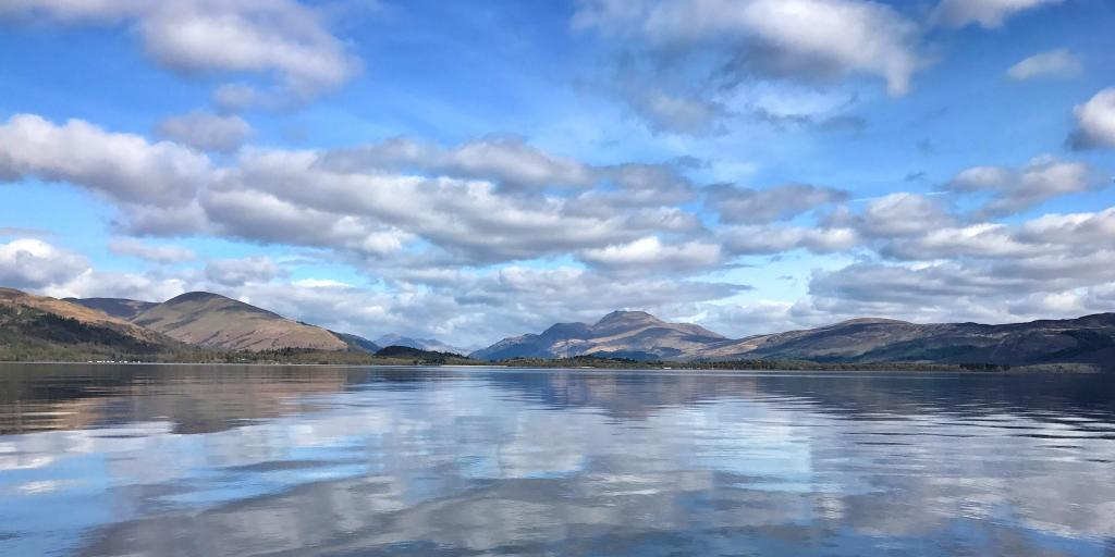 Reflections of the hills and clouds in Loch Lomond