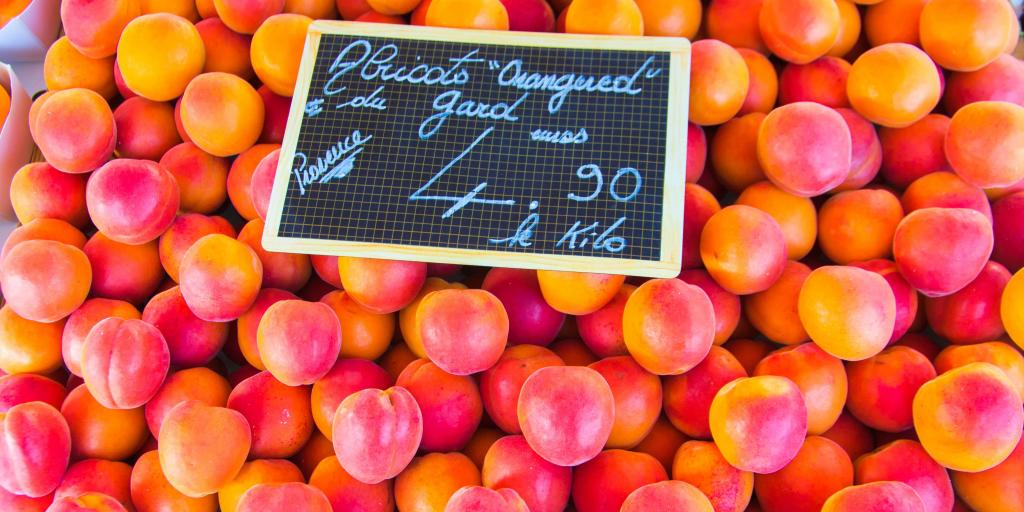 A close up of apricots at the Cours Saleya market, with a sign on saying they are 4.90 euros