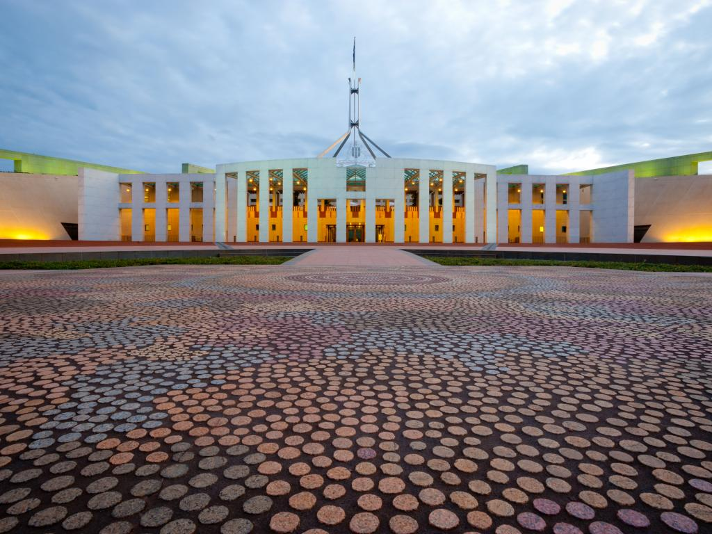 The new Australian Parliament House in Canberra at dusk.
