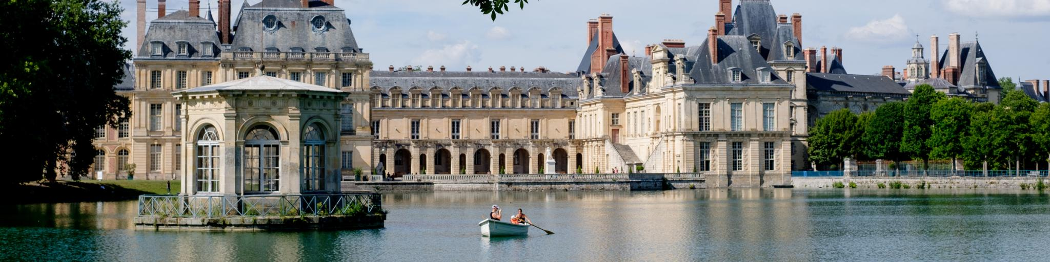 Rowers in the carp pond at Chateau de Fontainebleau