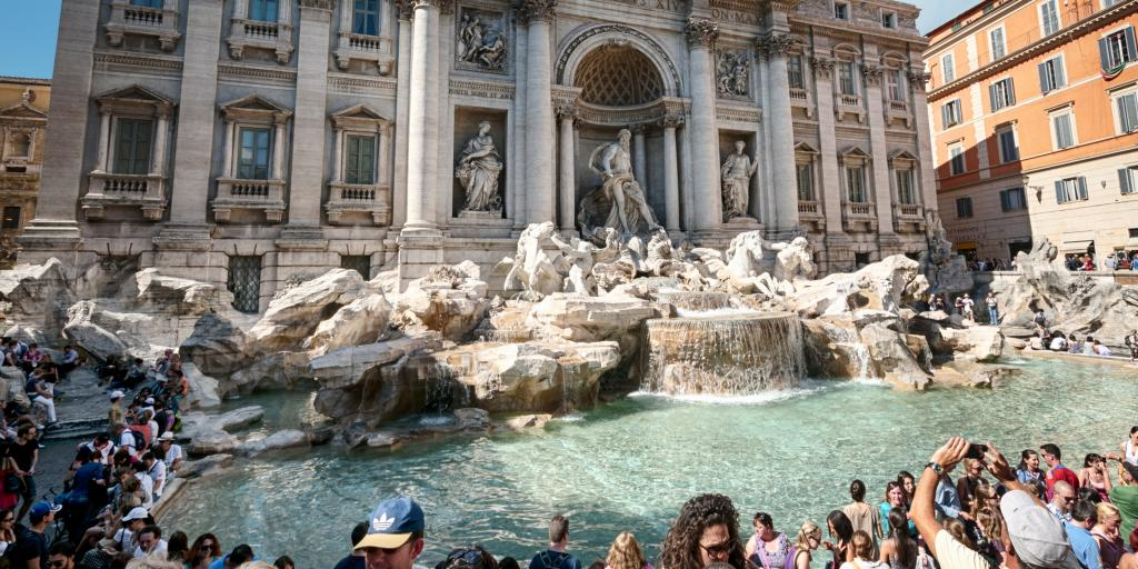 People enjoying the Trevi Fountain, Rome