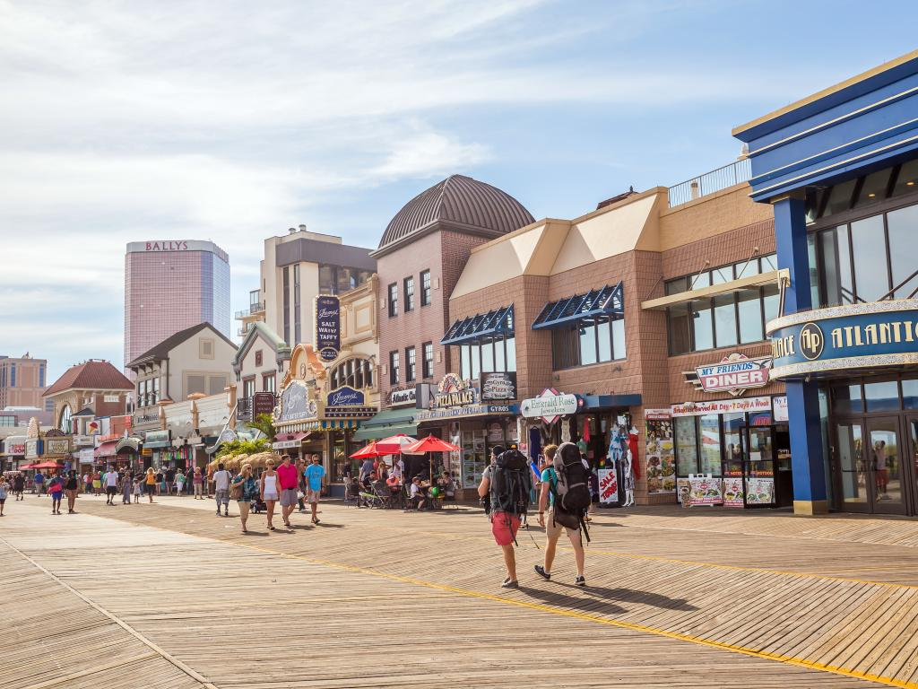 The pedestrian Boardwalk in Atlantic City, New Jersey with casinos and shops.