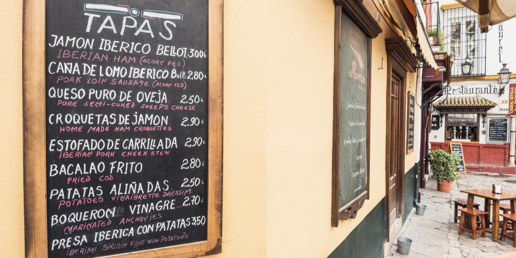 Tapas menu crawled on a blackboard in Seville, Spain