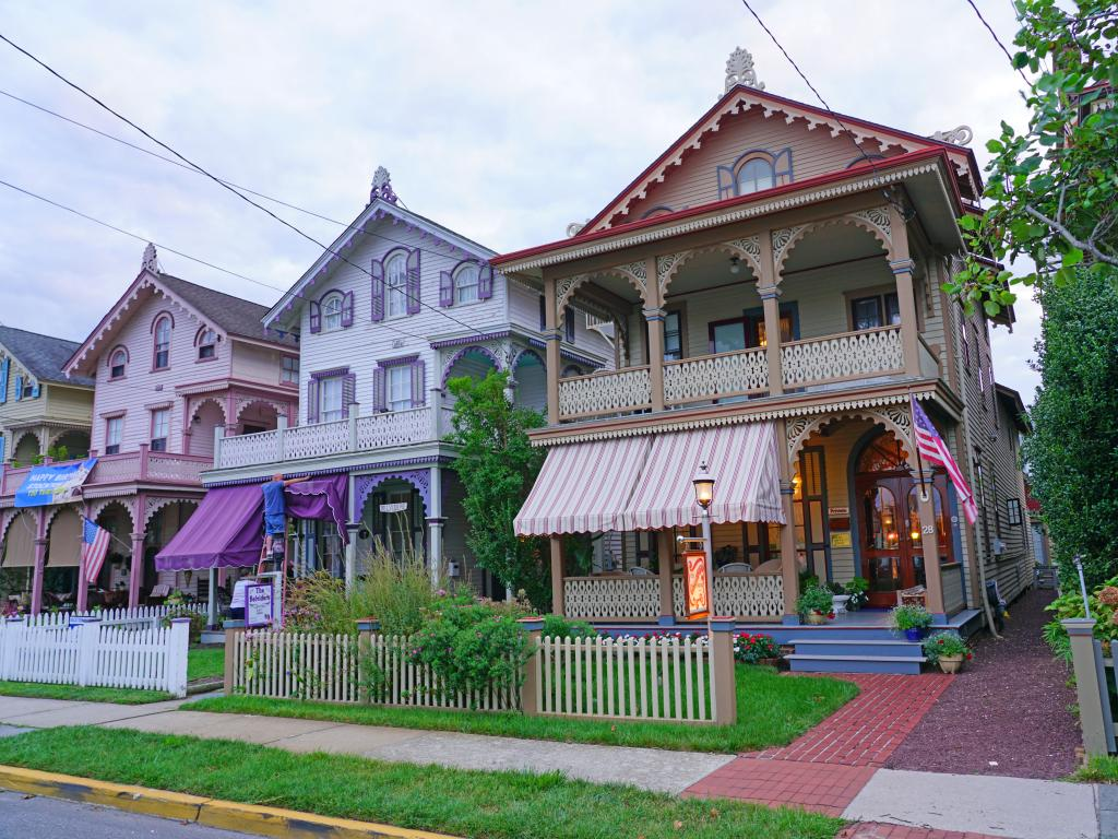 A street full of colorful historic Victorian houses in Cape May, New Jersey