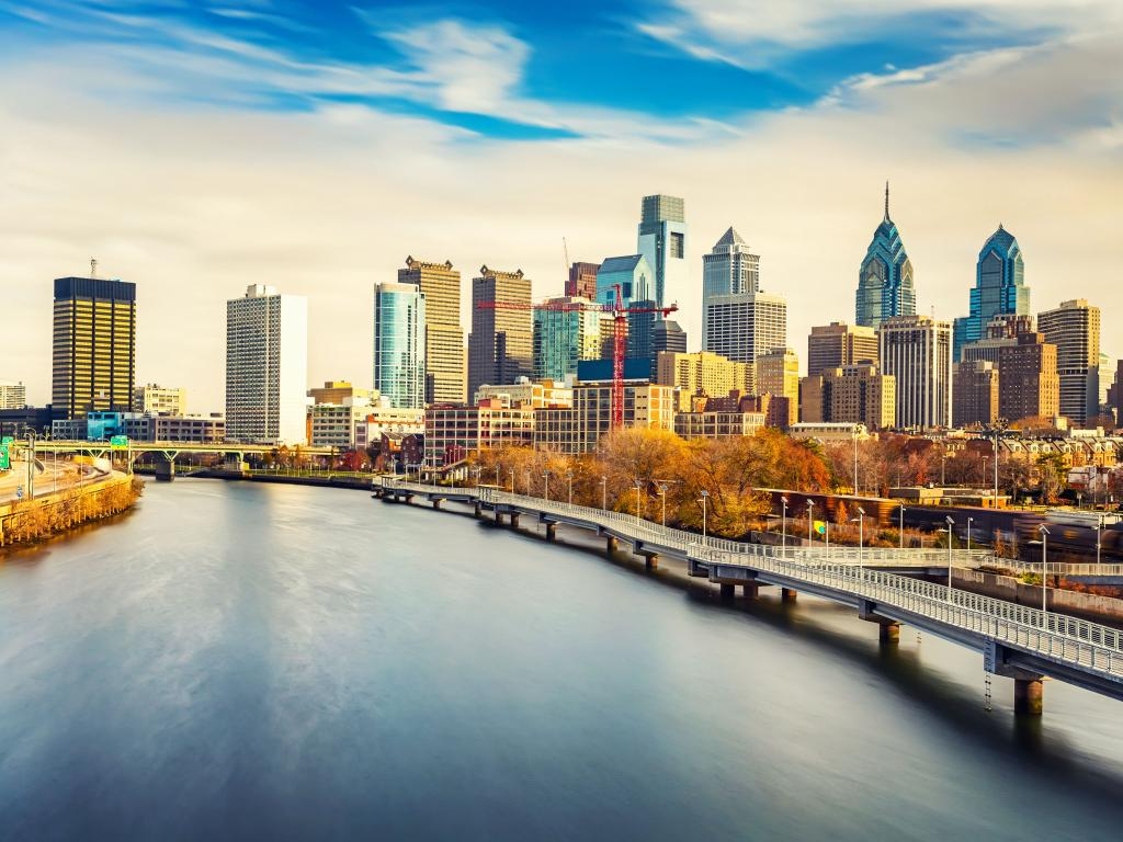 Panoramic view of Philadelphia skyline and Schuylkill river with patches of blue sky