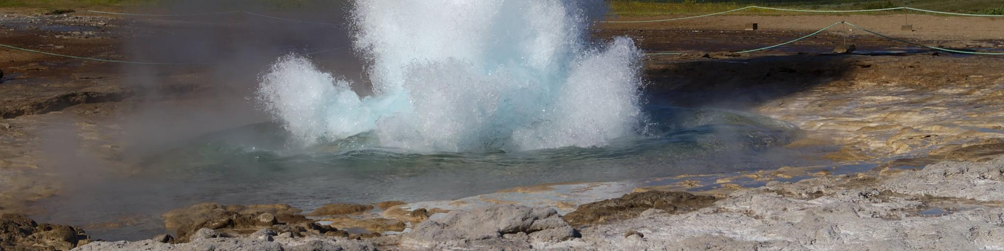 The famously lively Strokkur Geysir erupts with water