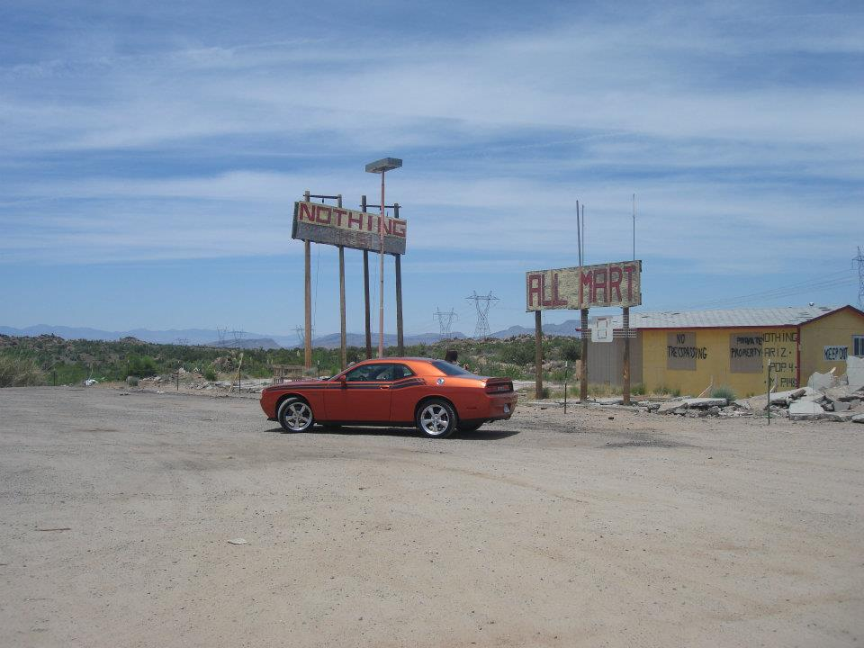 Dodge Challenger R/T parked in the town of Nothing, Arizona in the middle of the desert.