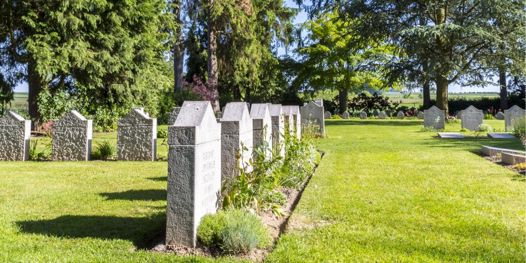 German graves at Saint-Symphorien Cemetery surrounded by grass and trees