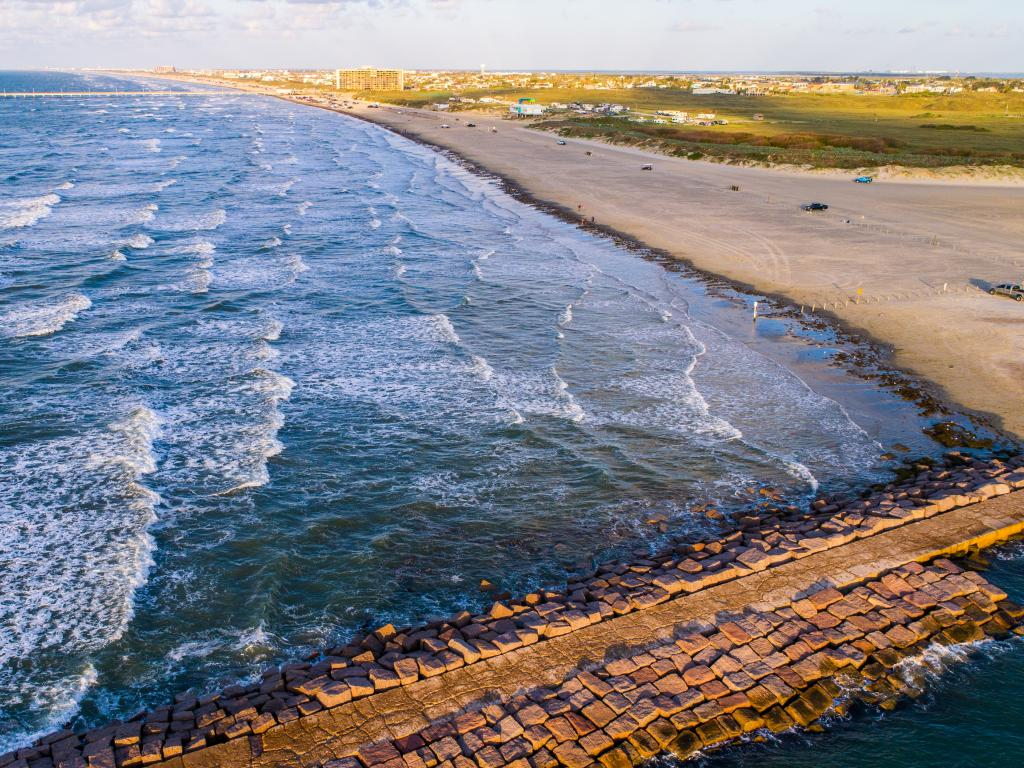 Scenic fishing pier and beach in Port Aransas on Mustang Island, Texas.
