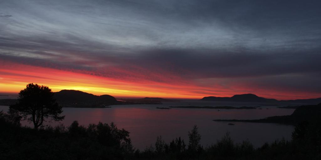 The fiery red sunset in Alesund as seen from Fjellstua viewpoint