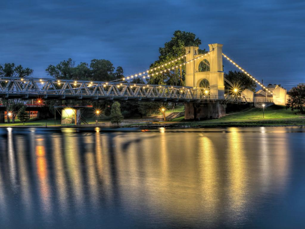 Historic Waco Suspension Bridge across the Brazos River in the evening in Waco, Texas
