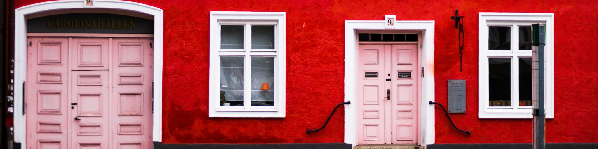 A red house with a pink door in the city of Malmo, Sweden