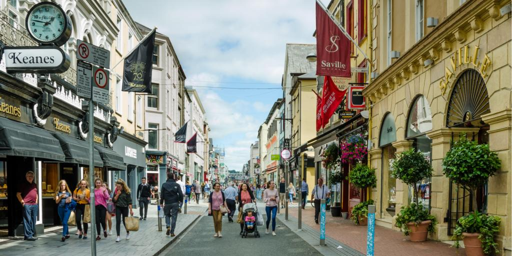 People walking down Oliver Plunkett Street in Cork, Ireland