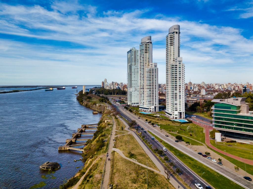Top view image of the bustling city of Rosario, Argentina with the Parana River on the left side and the skyscrapers on the right side.