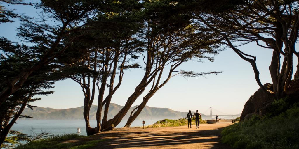 Couple walking in Presidio park with stunning views in San Francisco