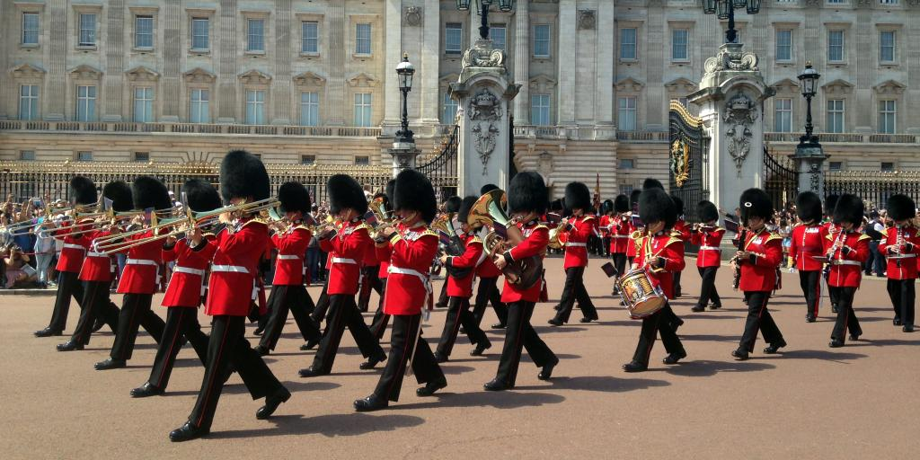 Soldiers playing musical instruments and marching at the changing of the guards ceremoney, London
