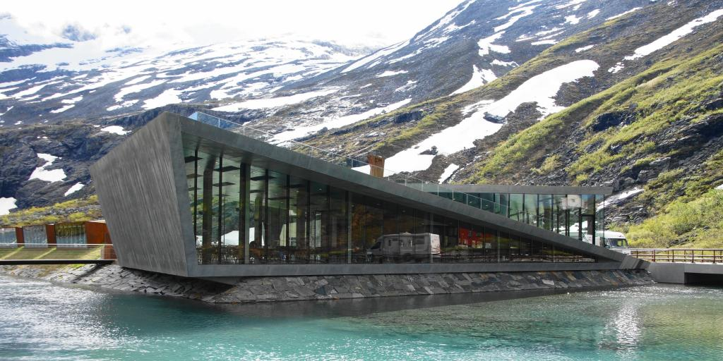The striking Trollstigen Visitor Centre building sits next to a river in Norway