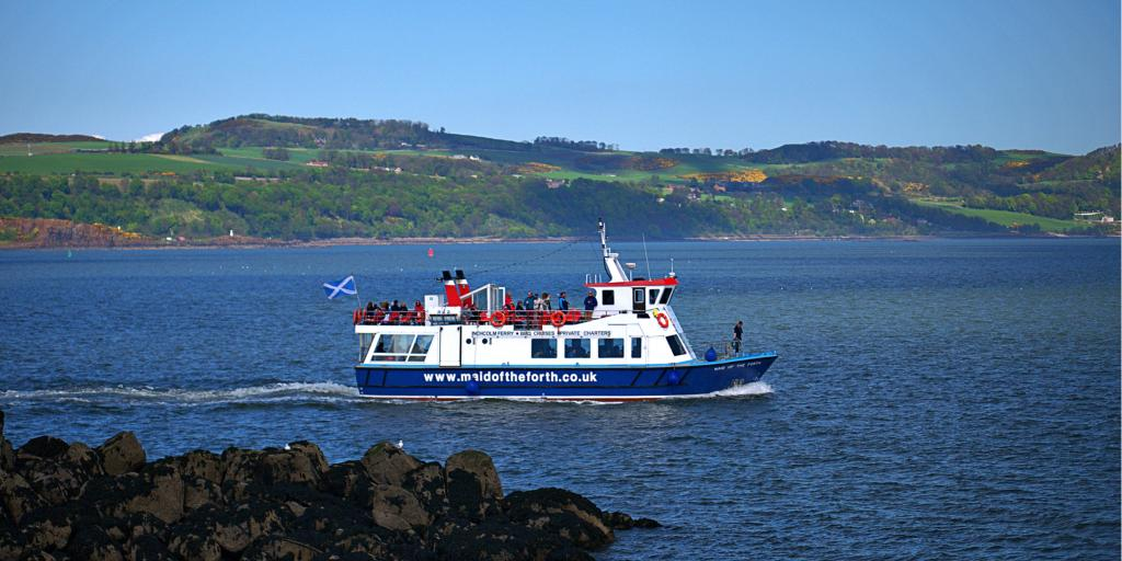 A ferry boat carries passengers through the Firth of Forth to Inchcolm Island near Edinburgh in Scotland